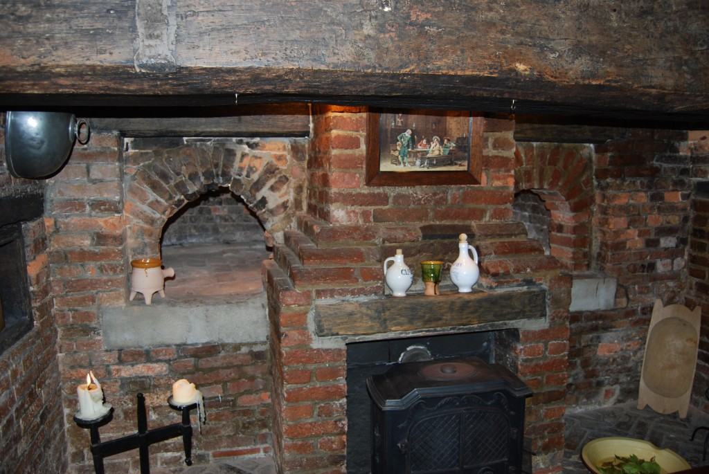Bread ovens within brick and stone inglenook fireplace