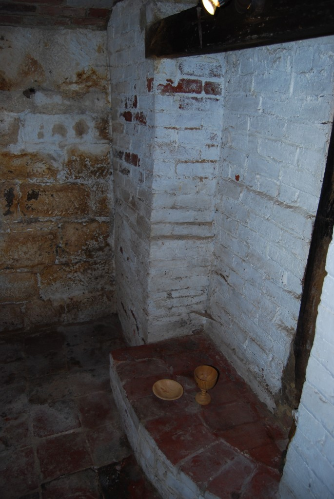 Cellar room, showing stone walling, and different phases of brick construction