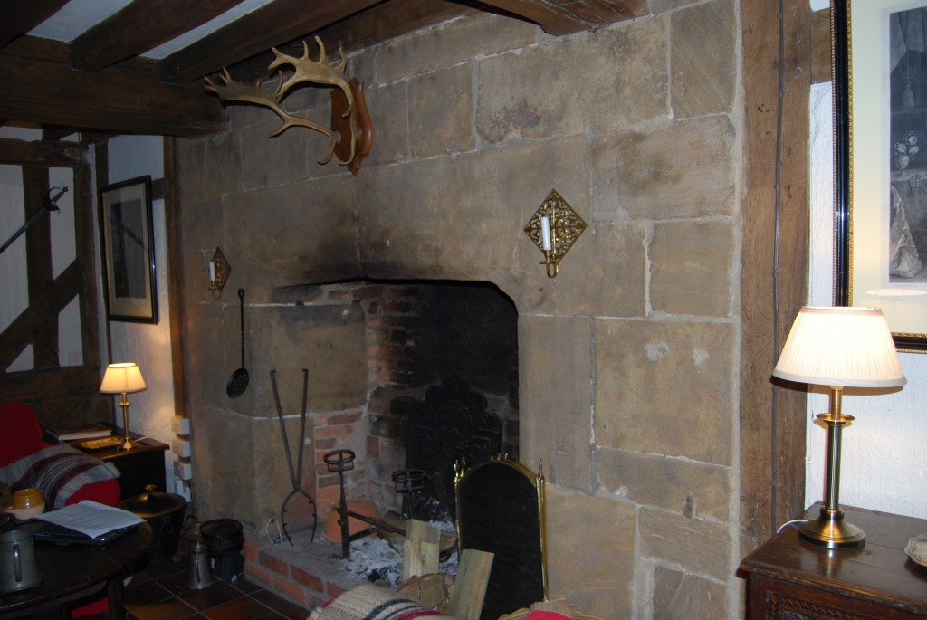 South wall of the Hall: location of blocked doors either side of the fireplace